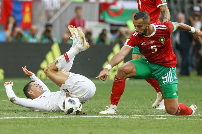 Cristiano Ronaldo (left) of Portugal in action against Mehdi Benatia of Morocco during the Fifa World Cup 2018 group B preliminary round soccer match between Portugal and Morocco at the Luzhniki Stadium, in Moscow, Russia, on June 20, 2018.