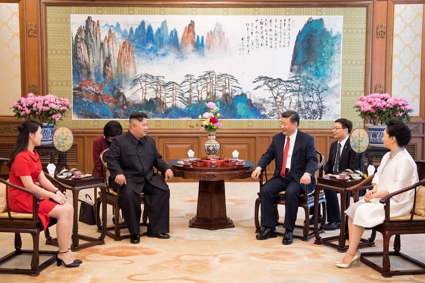 Mr Kim (second from left) and wife Ri Sol Ju (left) meeting Chinese President Xi Jinping and wife Peng Liyuan at the Diaoyutai state guest house yeterday.