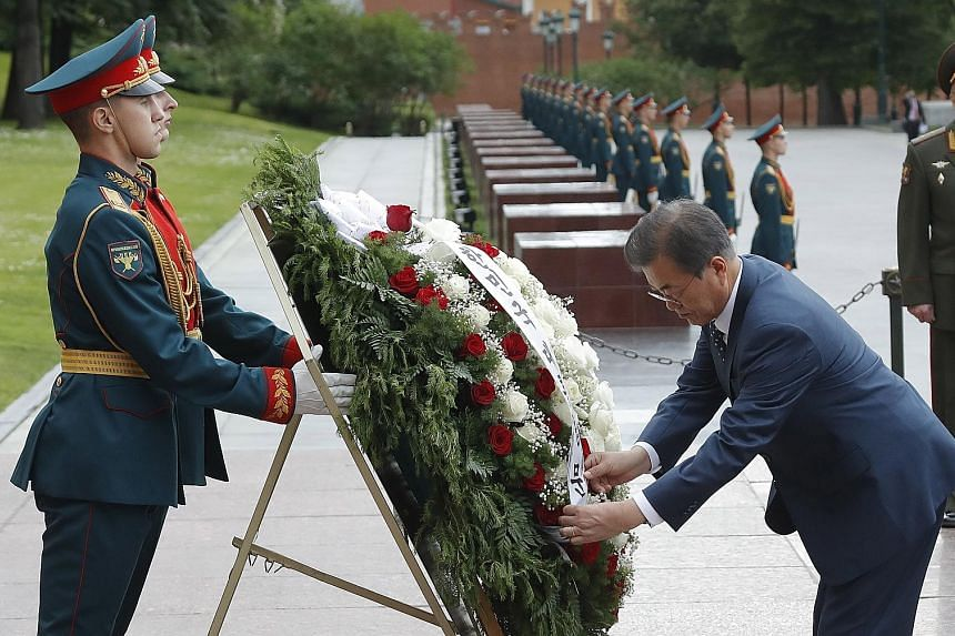 South Korean President Moon Jae-in attending a wreath-laying ceremony at the Tomb of the Unknown Soldier outside the Kremlin wall in Moscow yesterday as he began a three-day official visit. His talks with Russian President Vladimir Putin today are ex