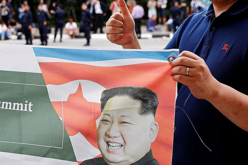 A show of support during the summit between US President Donald Trump and North Korea's leader Kim Jong Un in Singapore. The writer says the summit signalled a seismic change - namely that Mr Kim wants to reform the North Korean economy - and that th