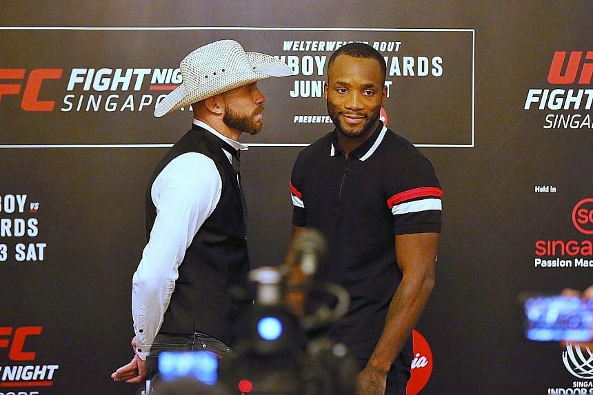 """Ultimate Fighting Championship (UFC) veteran Donald """"Cowboy"""" Cerrone (left) was in no mood for smiles when he faced off with Leon Edwards at the UFC Fight Night Singapore Media Day at the Mandarin Oriental hotel yesterday. In promotional interviews i"""