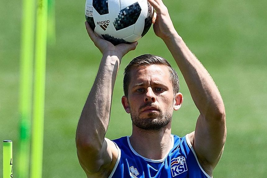 Iceland midfielder Gylfi Sigurdsson, seen here during training, played the full game against Argentina after winning his race to get ready for the Finals and is now fully fit, according to coach Heimir Hallgrimsson.