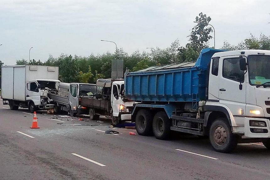The four-vehicle pile-up in Tanah Merah Coast Road on Wednesday. Driver Kulbir Singh was killed after he pulled over to help the driver of the tipper truck, whose vehicle had broken down.