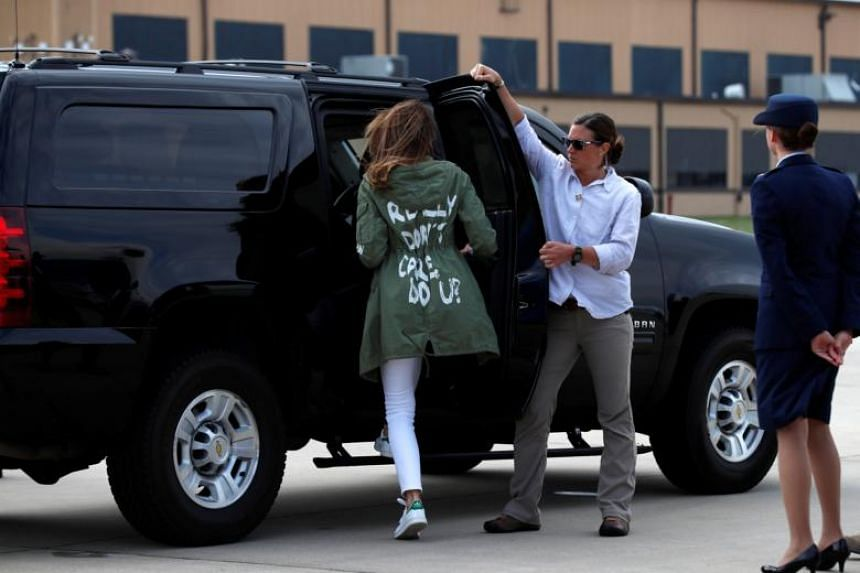 US First Lady Melania Trump climbs into her motorcade vehicle wearing a Zara design jacket with the phrase 'I Really Don't Care. Do U?' on the back as she returns to Washington from a visit to the US-Mexico border area in Texas, on June 21, 2018.