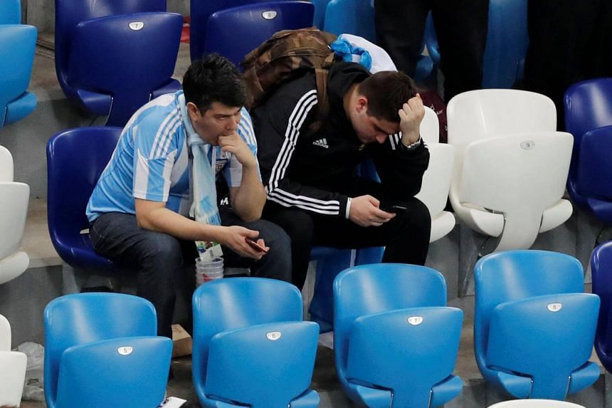 Argentina fans look dejected after the Russia 2018 World Cup Group D football match between Argentina and Croatia.