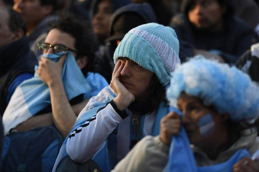 Argentina fans watch the Russia 2018 World Cup Group D football match between Argentina and Croatia on a giant screen at San Martin square in Buenos Aires, on June 21, 2018.