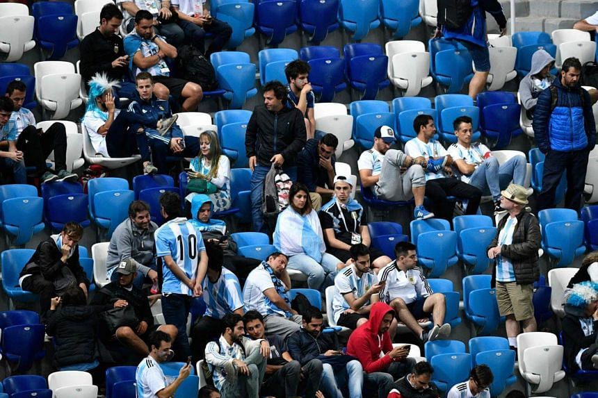 Argentina fans look dejected at the end of the Russia 2018 World Cup Group D football match between Argentina and Croatia.