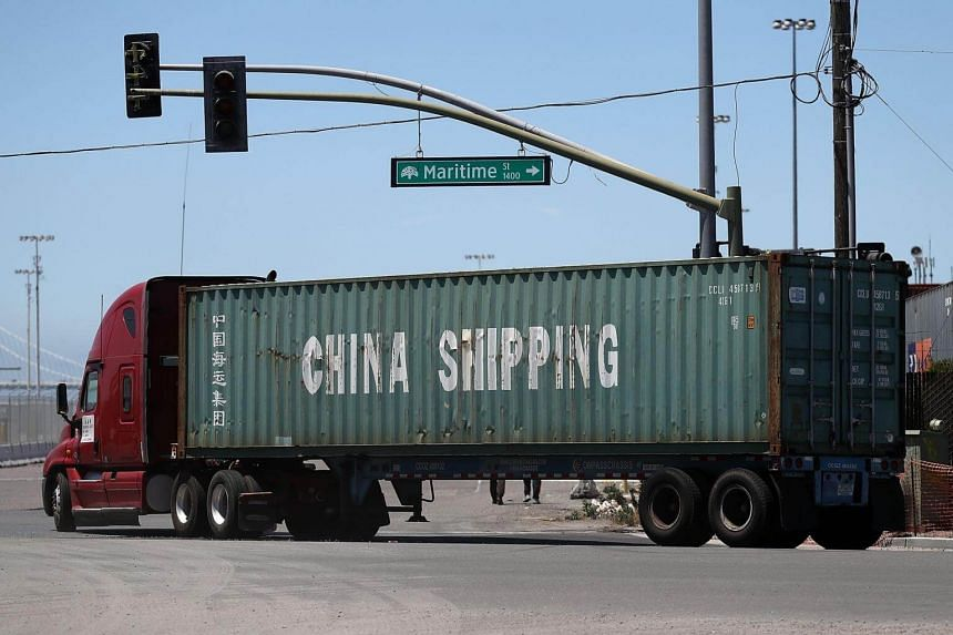 A truck carries a shipping container from China Shipping at the Port of Oakland in Oakland, California, on June 20, 2018.