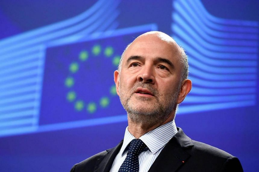 EU Economic Affairs Commissioner Pierre Moscovici speaks to press after a meeting at the EU headquarters in Brussels on June 20, 2018.