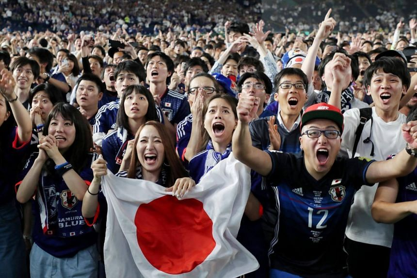 Japanese soccer fans celebrating Japan's victory against Colombia in the Russia World Cup Group H match between Japan and Colombia soccer in Tokyo, on 19 June, 2018.