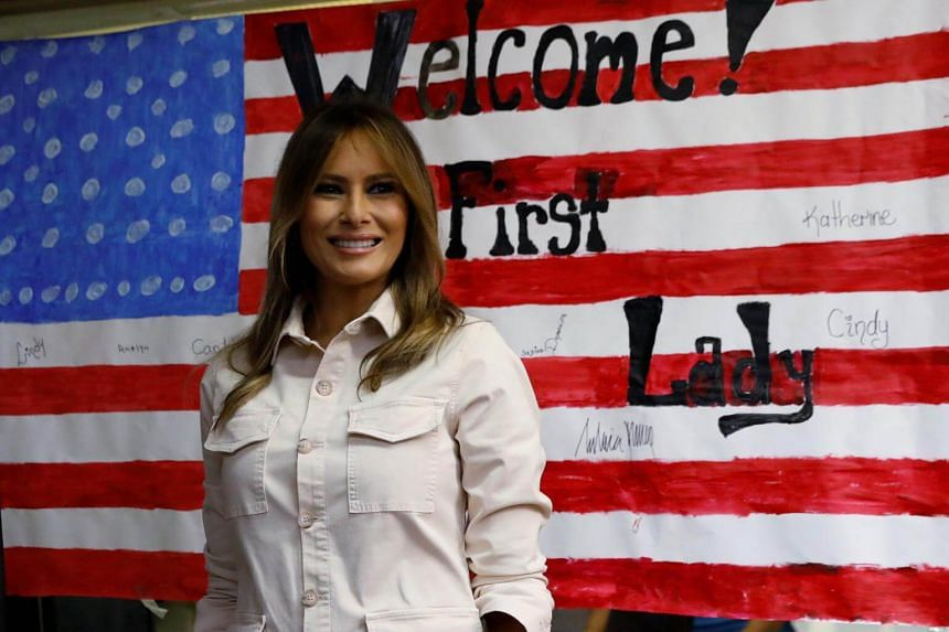 US First Lady Melania Trump poses in front of a US flag after touring the Lutheran Social Services of the South Upbring New Hope Children's Center near the US-Mexico border in McAllen Texas, on June 21, 2018.