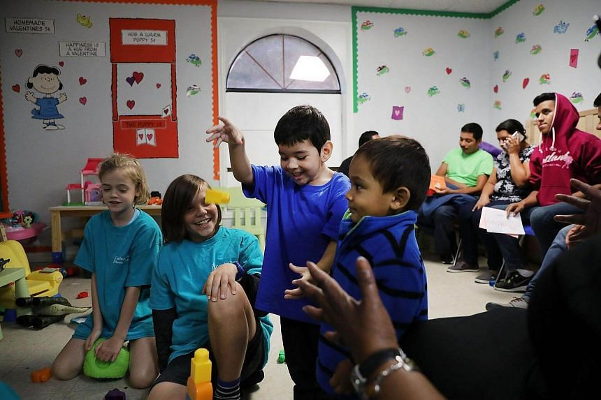 Recently arrived migrant children play with family and volunteer children at the Catholic Charities Humanitarian Respite Center in McAllen, Texas, on June 21, 2018.