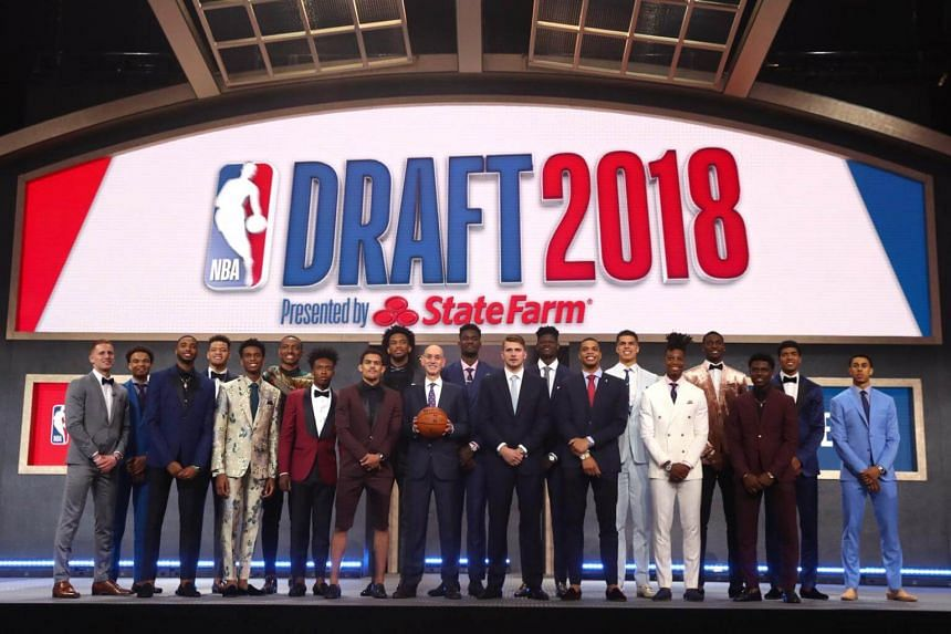 NBA Commissioner Adam Silver poses with (from left) Donte DiVincenzo, Jerome Robinson, Mikal Bridges, Kevin Knox, Shai Gilgeous-Alexander, Wendell Carter Jr., Collin Sexton, Marvin Bagley III, Trae Young, Deandre Ayton, Luka Doncic, Miles Bridges, Mi
