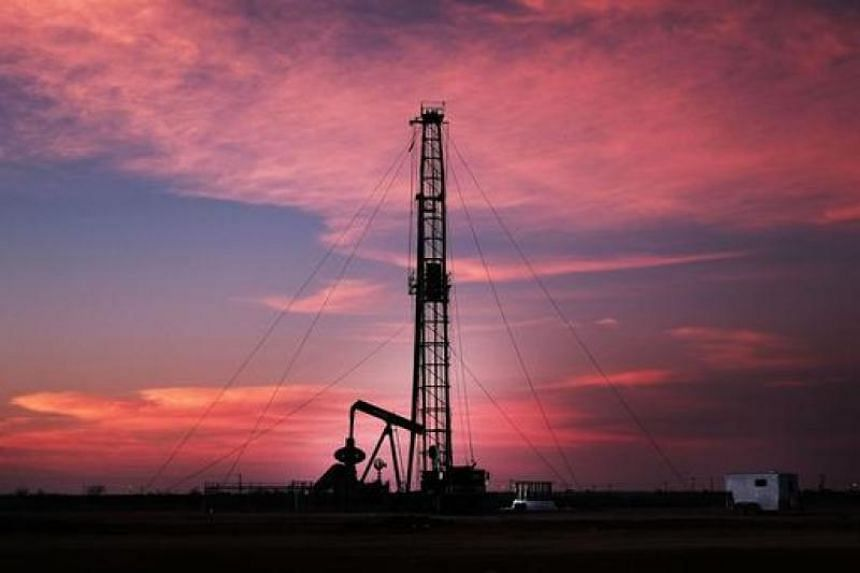 An oil drill near a construction site for homes and office buildings on Feb 5, 2015 in Midland, Texas.