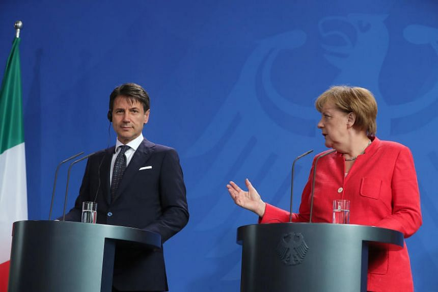 Germany's chancellor Angela Merkel (right) speaks as Italy's prime minister Giuseppe Conte listens during a news conference at the Chancellery in Berlin, Germany, on June 18, 2018.