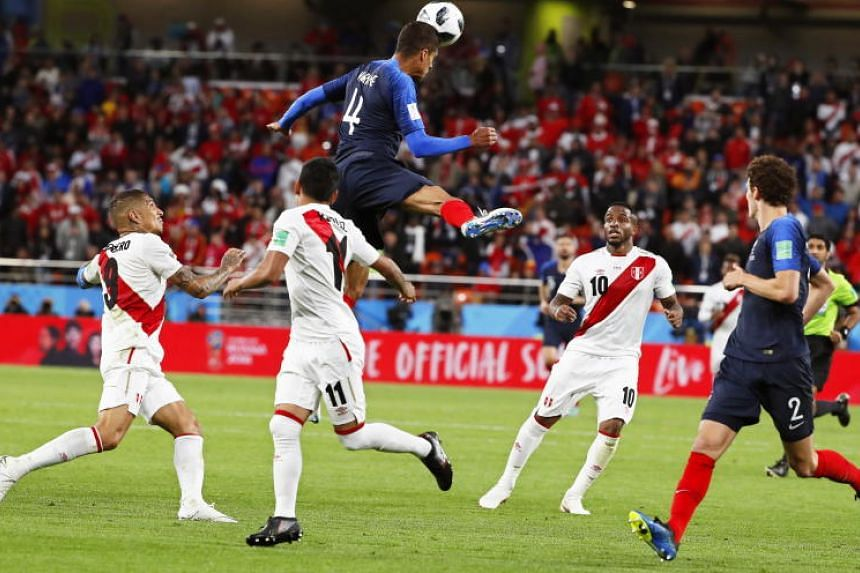 Raphael Varane (centre) of France in action during the Fifa World Cup 2018 group C preliminary round soccer match between France and Peru in Ekaterinburg, Russia, on June 21, 2018.