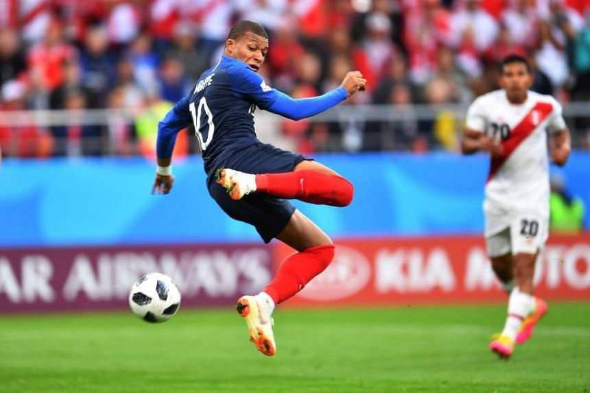 France's forward Kylian Mbappe attempts a shot on goal during the Russia 2018 World Cup Group C football match between France and Peru at the Ekaterinburg Arena in Ekaterinburg on June 21, 2018.
