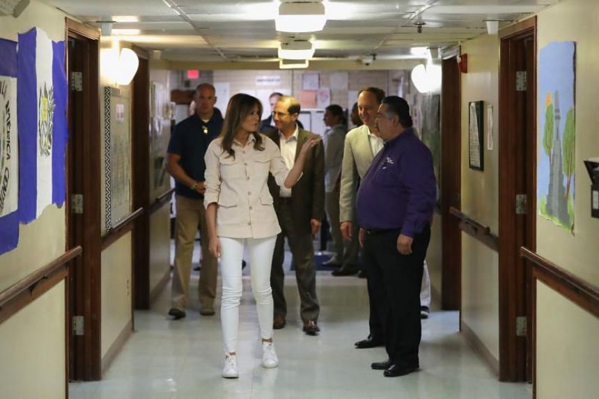 US first lady Melania Trump walks through the facility after a round table discussion with doctors and social workers at the Upbring New Hope Childrens Center on June 21, 2018 in McAllen, Texas.