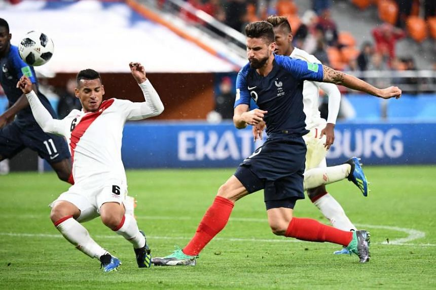 France's forward Olivier Giroud (centre) shoots the ball during the Russia 2018 World Cup Group C football match between France and Peru at the Ekaterinburg Arena in Ekaterinburg on June 21, 2018.
