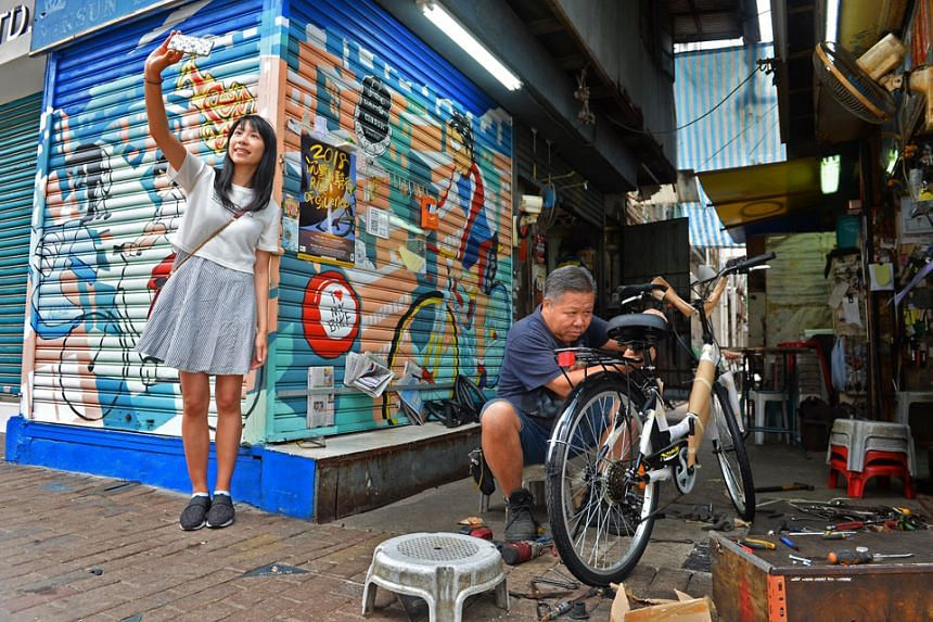 Graffiti on shop shutters and buildings add to Sham Shui Po's vibrance. PHOTO: CHONG JUN LIANG