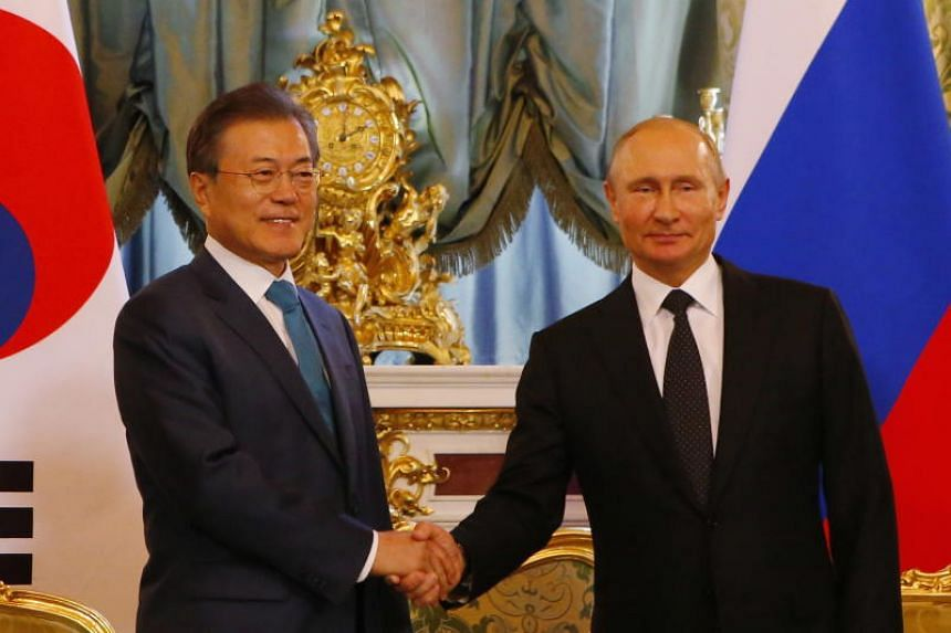 Russian President Vladimir Putin and South Korean President Moon Jae-in meet in the Kremlin in Moscow on June 22, 2018.