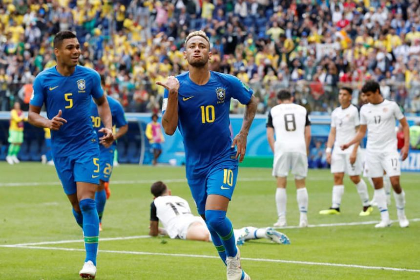 Brazil's Neymar celebrates scoring their second goal during their World Cup Group E match against Costa Rica at Saint Petersburg Stadium on June 22, 2018.