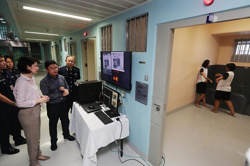 Senior Parliamentary Secretary for Home Affairs and for National Development Sun Xueling (second left) toured the A4 cluster of the prison to see the new initiatives.