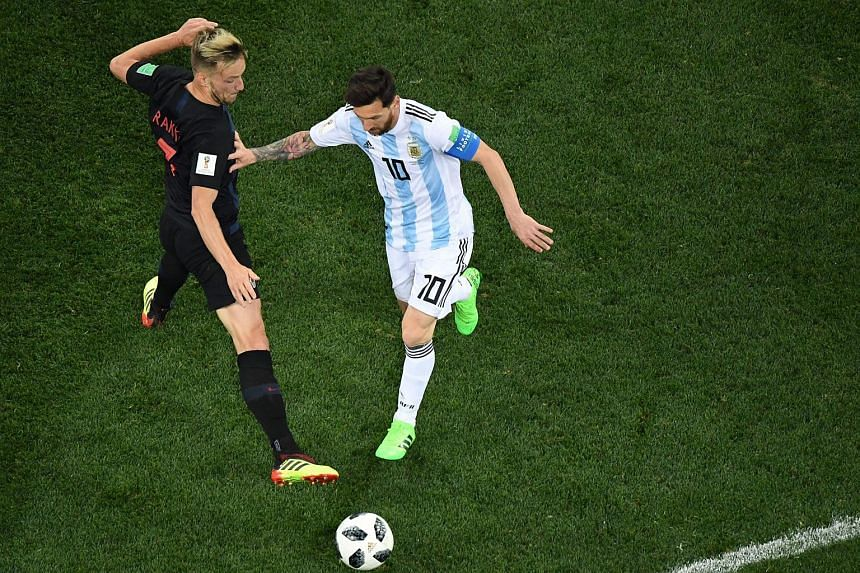 Argentina's forward Lionel Messi (right) vies with Croatia's midfielder Ivan Rakitic during the Russia 2018 World Cup Group D football match at the Nizhny Novgorod Stadium in Nizhny Novgorod, on June 21, 2018.