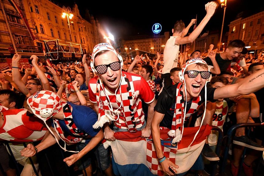 Croatia's fans react after their national team beat Argentina 3-0 in the Russia 2018 World Cup group D football match, in Zagreb, on June 21, 2018.