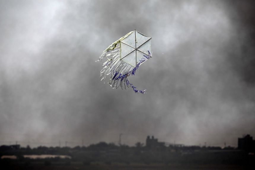 A kite flies over the border in an area where kites and balloons have caused blazes, between Israel and the Gaza strip, on June 8, 2018.