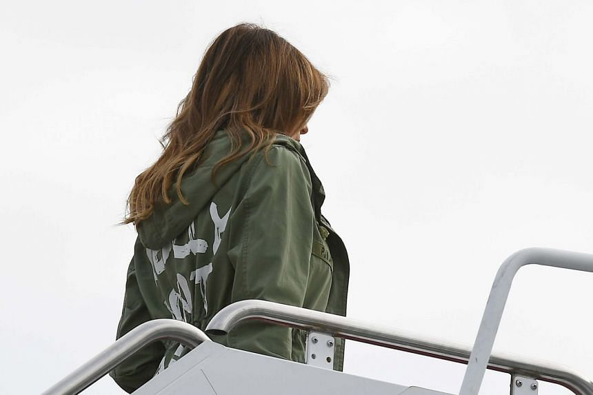 Mrs Trump boards a flight at Andrews Air Force Base in Maryland wearing the rain jacket.