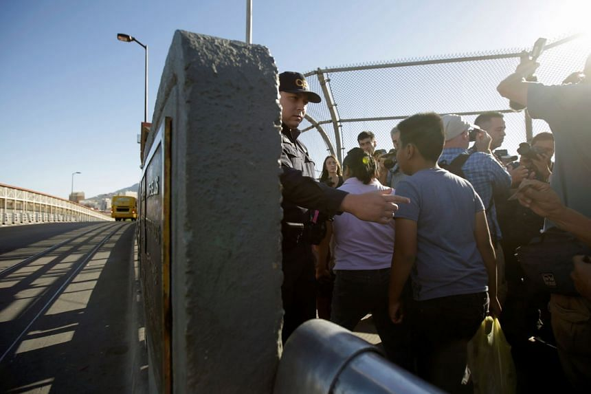 Migrant families from Mexico entering the United States to apply for asylum at the Paso del Norte international border crossing bridge in Ciudad Juarez on Wednesday.