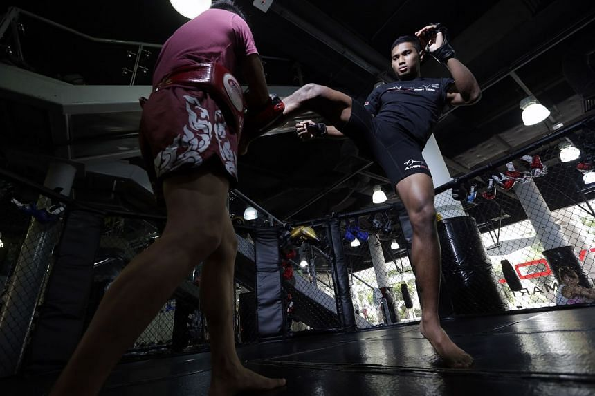 Singapore MMA fighter Amir Khan at a training session at Evolve Gym in 2015. The 10-year-old chain has four outlets in Singapore and its fighters have taken part in international fight promotions.