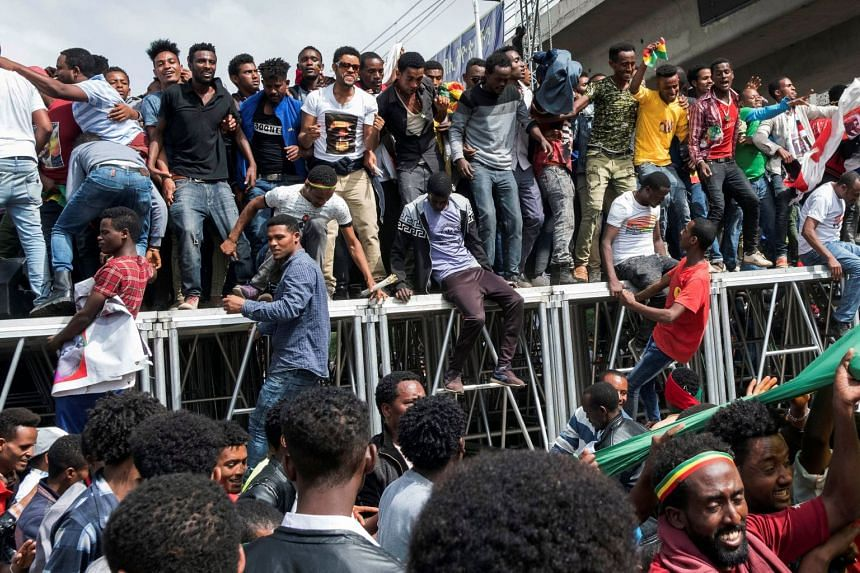 Ethiopians jostle to jump from the podium during a rally in support of the new Prime Minister Abiy Ahmed in Addis Ababa, Ethiopia, on June 23, 2018.