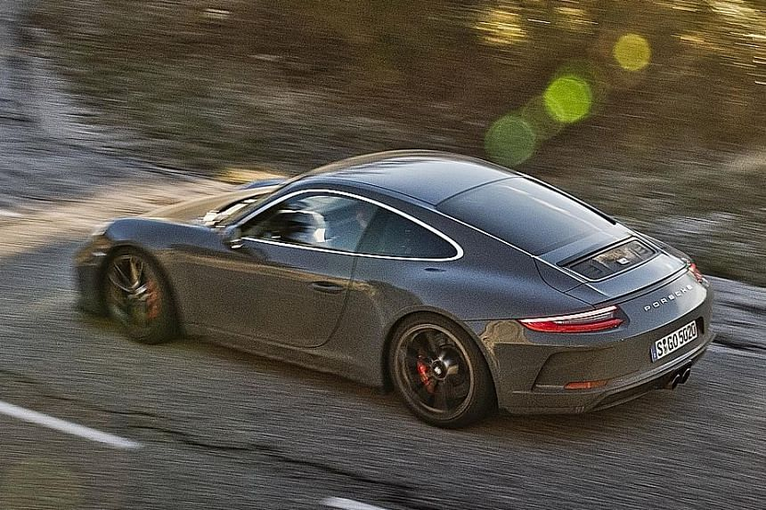The Porsche 911 GT3 Touring preserves the 911's classic slant-back silhouette, without the GT3's trademark tall rear wing.