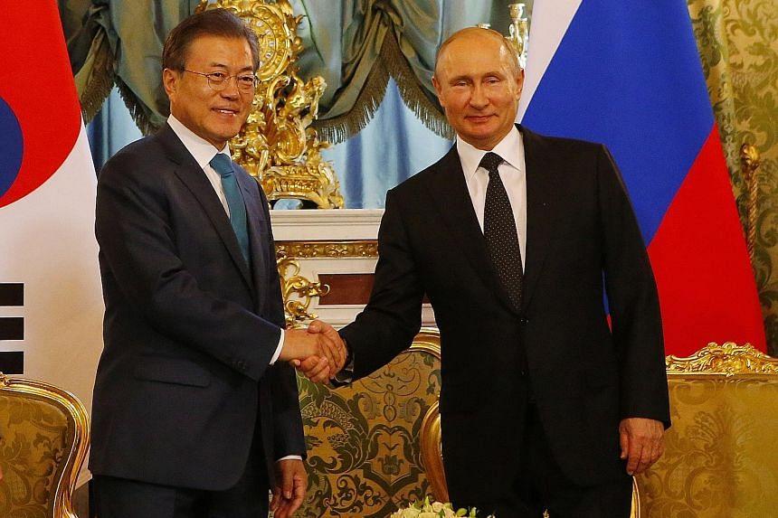 South Korean President Moon Jae-in meeting Russian President Vladimir Putin in the Kremlin yesterday. Mr Moon arrived in Russia on Thursday, the first official visit by a South Korean president since 1999.