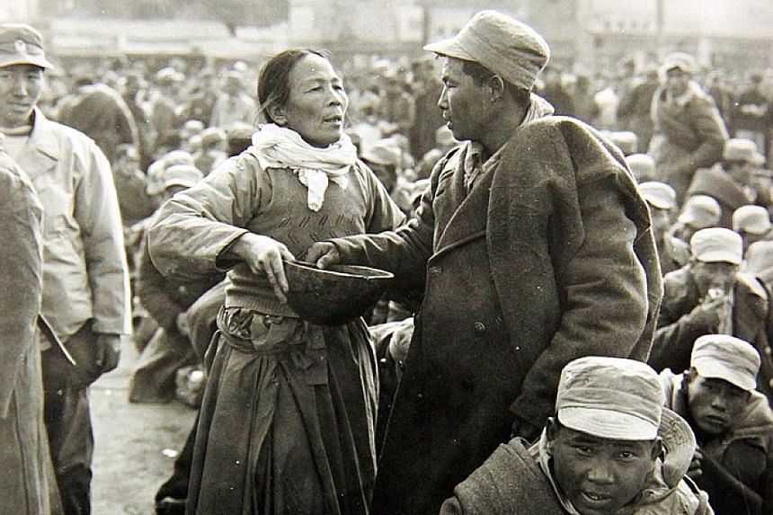 A mother and her son bidding farewell to each other at a railway station in Daegu, South Korea, during the Korean War in December 1950.