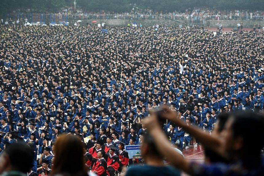 A graduation ceremony at Wuhan University in Hubei province yesterday. Mandatory ideology classes have been updated by Chinese universities in response to instruction from the leadership that President Xi Jinping's ideas must enter the textbooks, cla