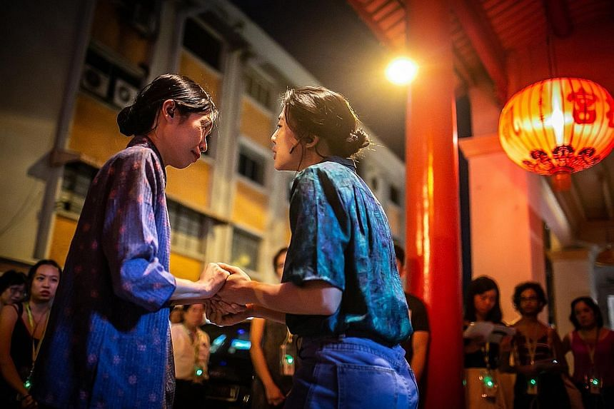 Jodi Chan (far left) and Sabrina Sng play former residents of Chinatown in a promenade theatre experience by Drama Box.