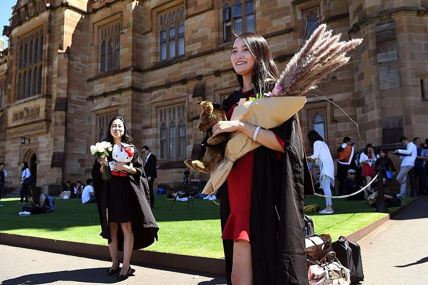 Graduates posing for photos at a Sydney university. Supporters of the proposed Western civilisation course said it was vital for Australian universities to promote Western culture and civilisation. Critics said it represented a narrow ideological wor