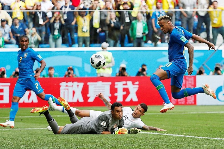 Neymar tapping home a cross from Douglas Costa (unseen) for Brazil's second goal as the Costa Rican rearguard of Keylor Navas and Francisco Calvo can only look on despairingly in stoppage time.