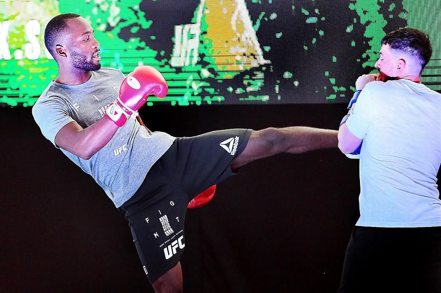 """Leon Edwards working out with his trainer ahead of tonight's UFC Fight Night Singapore event at the Indoor Stadium, where his opponent Donald """"Cowboy"""" Cerrone is going for a record 21st UFC victory."""