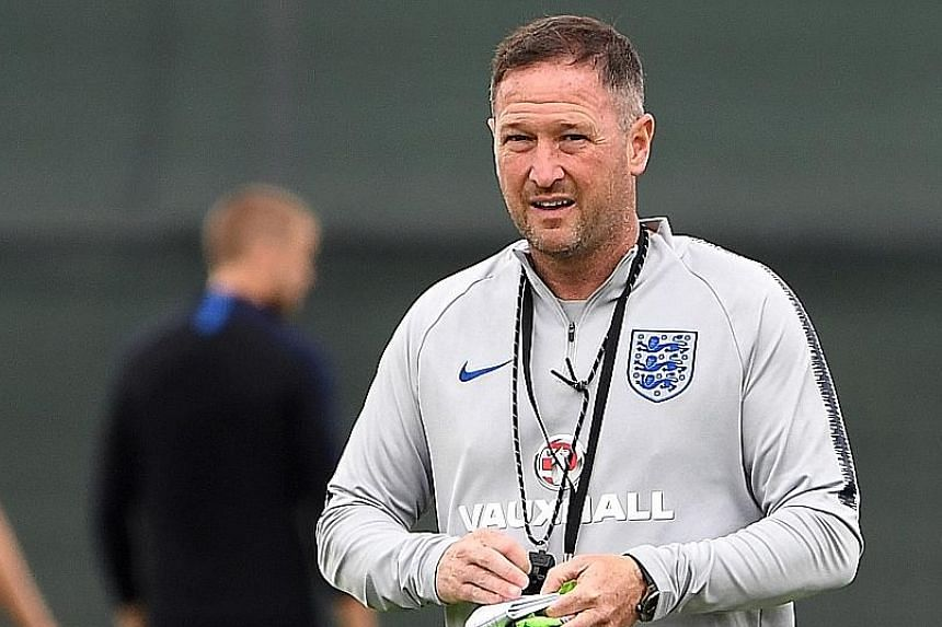 England's assistant coach Steve Holland had been photographed walking onto the training pitch at Spartak Zelenogorsk's stadium, clutching a sheet of paper on which seemed to be written the starting XI for the Panama match.