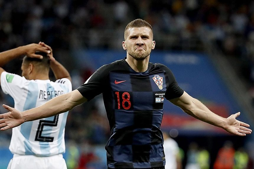 Croatia winger Ante Rebic celebrating his opener against Argentina on Thursday. Zlatko Dalic's men have qualified for the knockout stages and need a point to finish top of Group D.