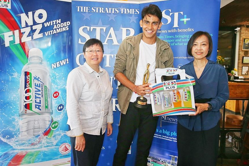 ST Star of the Month, sprinter Zubin Muncherji, a student at the University of Indiana, receiving his award from Straits Times sports editor Lee Yulin (far left) and a 100 Plus pack from F&N Foods general manager Jennifer See.