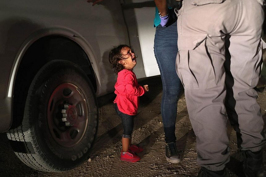 The Honduran toddler crying as her mother was being searched near the US-Mexico border on June 12. Mother and child have been detained together.