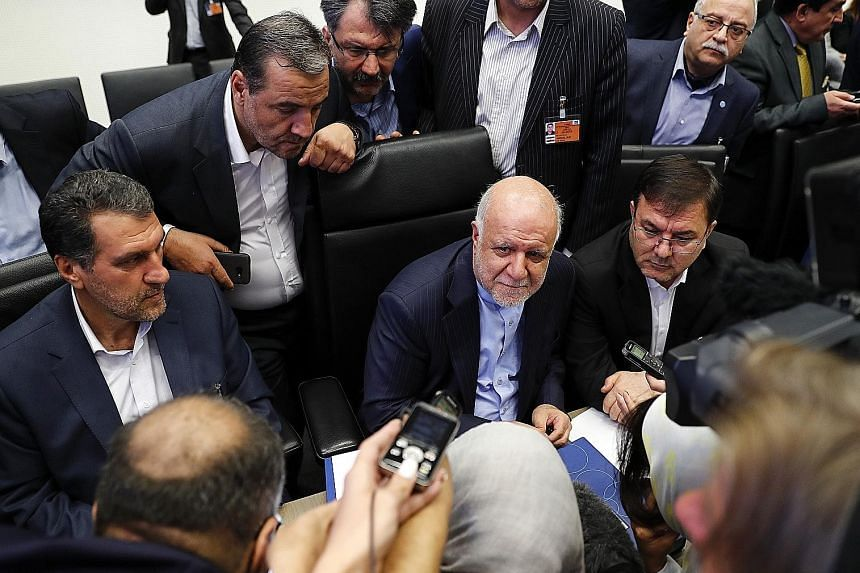 Iran's Petroleum Minister Bijan Namdar Zanganeh (centre) at a press conference ahead of Opec's meeting in Vienna, Austria, yesterday.