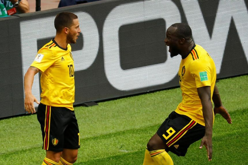 Belgium's Eden Hazard celebrates scoring their fourth goal with Romelu Lukaku during their World Cup Group G match against Tunisia at the Spartak Stadium in Moscow on June 23, 2018.