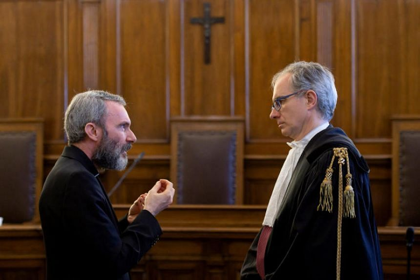 Monsignor Carlo Alberto Capella  (left), a Catholic priest sentenced to five years in jail for possessing child pornography, talks with his lawyer during a trial at the Vatican June 23, 2018.