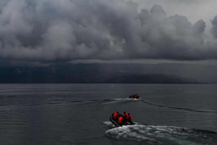 Indonesian rescue team officers conduct a search operation for the missing victims of a capsized ferry at Lake Toba, in North Sumatra province, on June 23, 2018.
